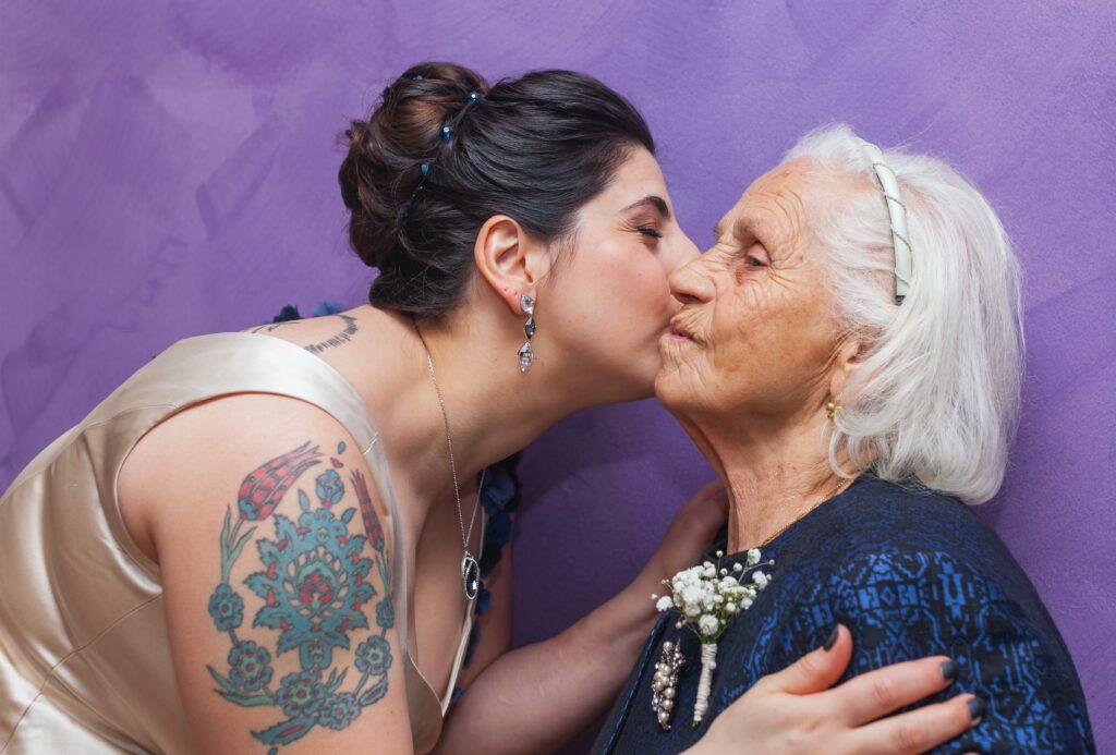 International Women's Day: Woman kissing an older woman